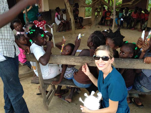 Photo of Dr. Cristi Cheek of East Cobb with children in a village in Haiti for whom she provided dental care through the 410 Bridge, a Christian mission organization.