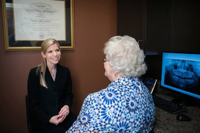 Dr. Cheek Visiting with Patient