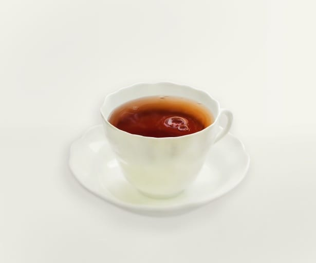 tea in a white cup and saucer